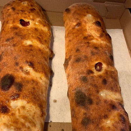 Stuffed breads that are huge! Two breads fit in a large pizza box! Get a side of sauce. Definitely the largest breads in the area and for the price feed 10 people!