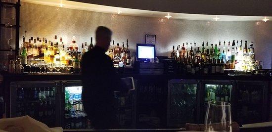The backlit bar, at Orange Sky Restaurant in the Talking Stick Resort, Phoenix, AZ.