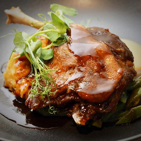 Free range confit duck, chorizo mash, charred plums, French beans, thyme jus.