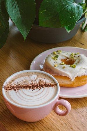 hazelnut mocha and a white chocolate pistachio donut