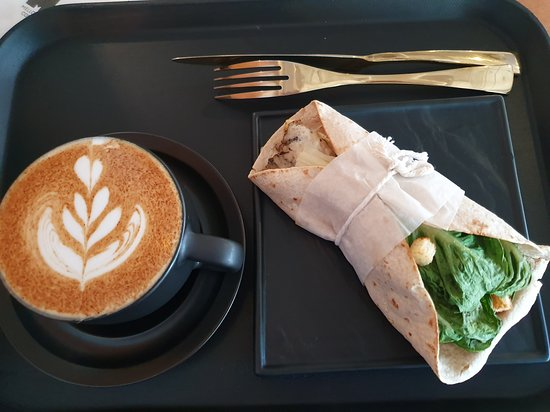 Chai Latte accompanied by Grilled Chicken Wrap