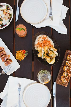 Loquita showcases authentic Spanish food including hot and cold tapas, wood-fired grilled seafood and meats, and seasonal paella.