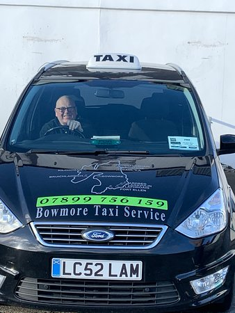 Peter Campbell of Bowmore Taxi at your service!