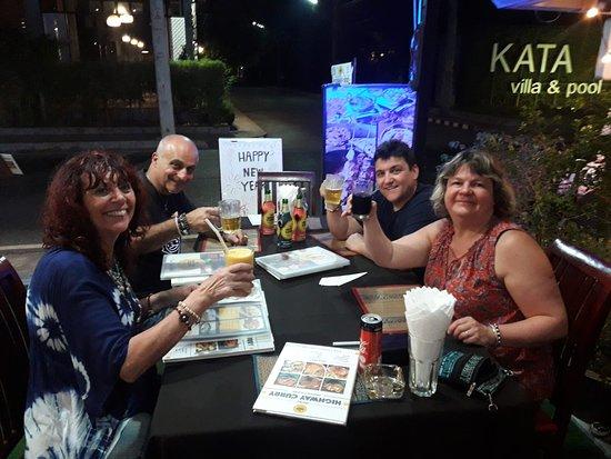 Beautiful friends enjoying Mango lassi and beers