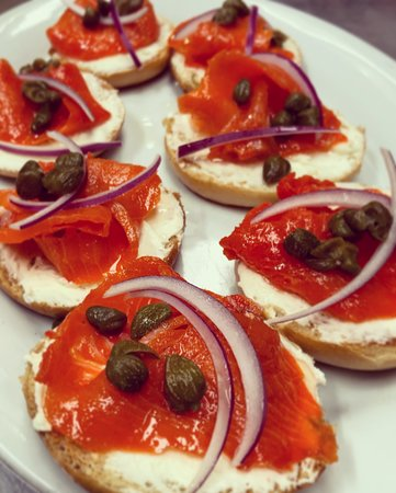 Mini bagel with cream cheese, smoked trout, and capers.