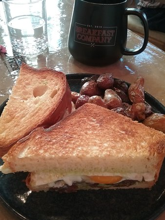 Breakfast sandwich was yummy but messy to eat; will ask to have the egg cooked a little more.