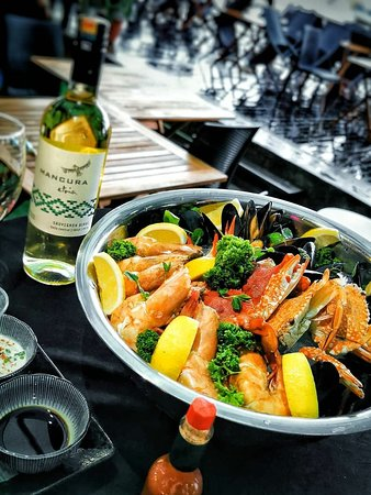 Seafood on nice bowl. Prefect match with white wine