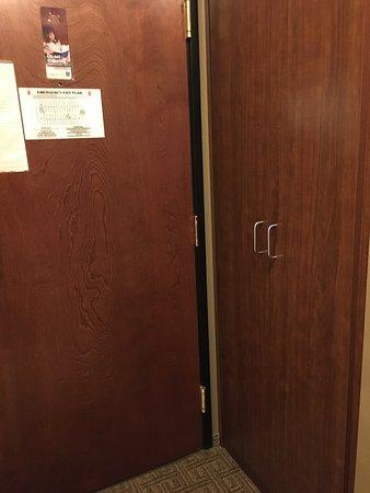 Closet across the bathroom along the entrance hallway