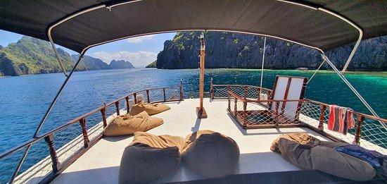Full Day El Nido Island Frontier Group Tour B: Wooden Boat Deck
