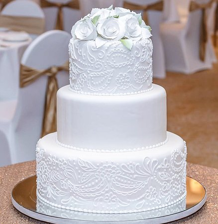 Keeping things simple with this elegant 3 tier ribbon cake ~ Get your cakes customized for any occasion with us!