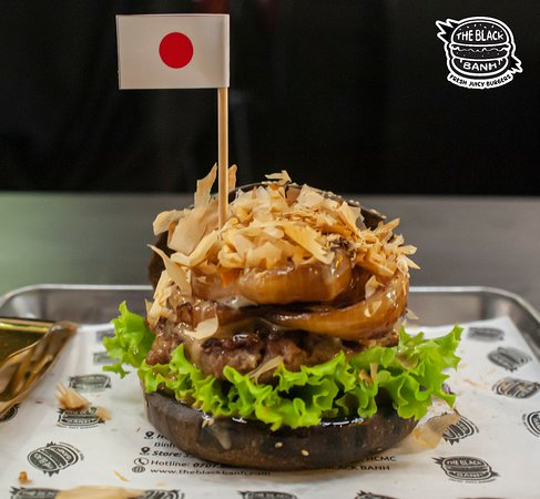 Japan Burger with Beef, Grilled Onions, Bonito Flakes, and Smoked Teriyaki Aioli.