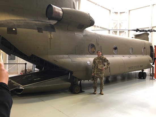 Fort Rucker, AL: My nephew standing next to a Chinook helicopter in the U.S. Army Aviation Museum, which he plans to fly in his future.