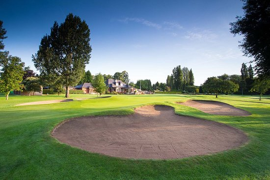 Hole 9 - Par 4 - 338 yards.   Drive up the centre avoiding the stream at 160 yards and the right hand fairway bunker.  Then a short iron into a long well bunkered green.