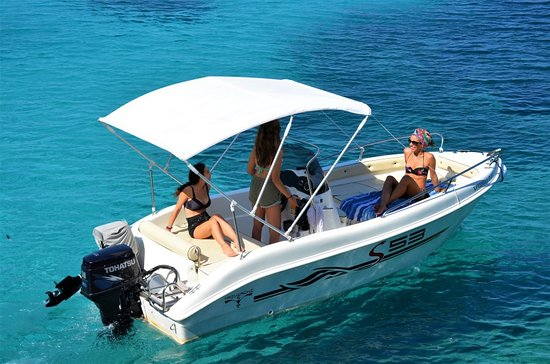 Panos Boats & Trips: Trimarchi 53S-a deluxe boat with shower and music to travel your family and friends all around Paxos and Antipaxos