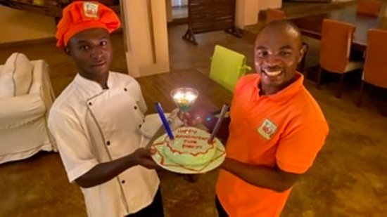 Bulago Island, Уганда: Patrick (cook) & Fred (waiter) with the cake for our anniversary