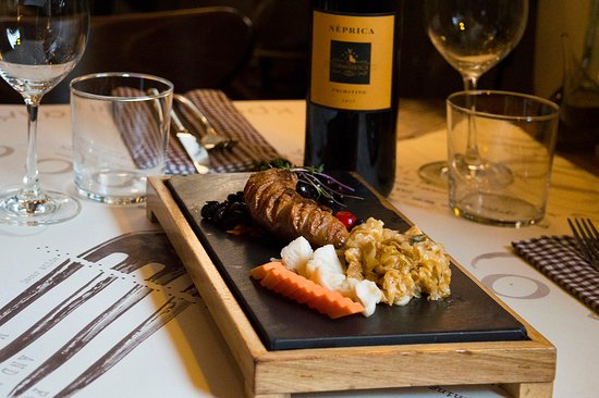 Grilled homemade sausage + podvarak + black beans + homemade pickled vegetable + honey mustard with juicy red fruit + black cheries and floral violets aromas in a glass of Italian red wine Neprica = Project 72 Wine&Deli Creative Local Cuisine