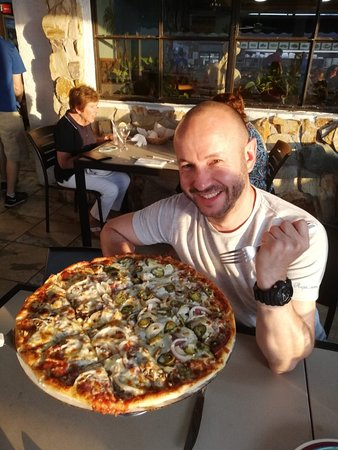 Huge pizza and lovely setting