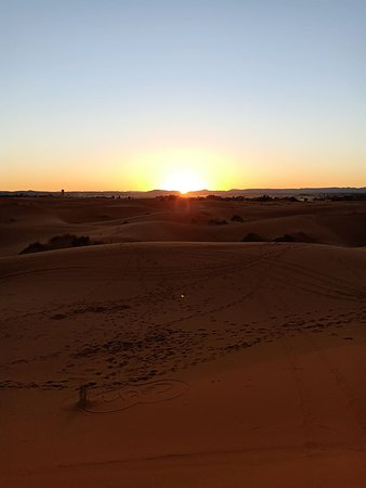 sunset in the erg chabbi dunes