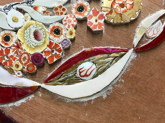 Sutton Courtenay, UK: Making mixed media mosaic by Emma Cavell.  Work in progress detail.  using a mix of re-cycled china, stained glass, vintage gold china.       Contact Emma.  emmacavell22@gmail.com      www.emmacavellart.com   Instagram & Pinterest - emmacavellstudio