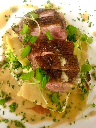Duck breast with ravioli and green peppercorn sauce