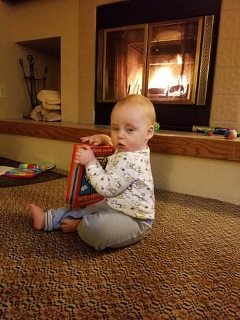 Jackson Hole Lodge: My baby derping in front of the fireplace. Reading by firelight!