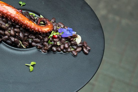 Grilled octopus, served with black beans with a load of extra virgin olive oil and fresh microgreens. Best paired with sparkling wine from Serbian Komuna winery and the loved one ❤️  Happy Valentine's Day!