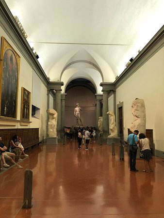 "the hall leading to David. Somewhere along here is a ""selfie"" sculpture of Michelangelo"