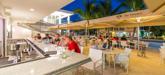 Have drinks at the bar or sit down at any of our indoor or outdoor tables at The Terrace on Grace Bay