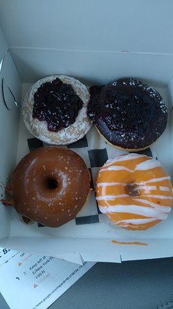 Oakhurst, NJ: These were the four donuts that I bought to try: A powdered donut with black raspberry jelly, Coach K - black raspberry preserves and chocolate, The Nantucket - caramel and sea salt and finally the Creamsicle - orange glaze with a vanilla drizzle.