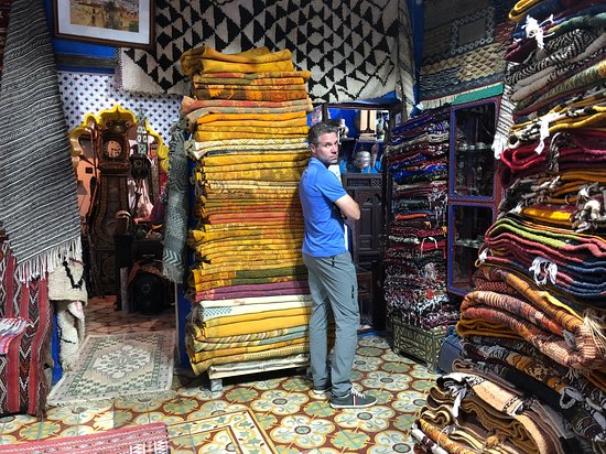 Hubby looking through the gazillion beautiful rugs