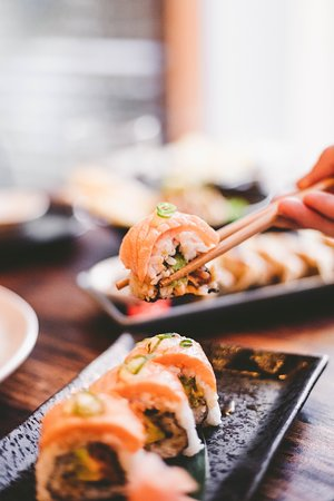 Salmurai Roll - Tasmanian salmon, avocado, sriracha mayo, wrapped in rice, with more sashimi grade salmon which is flame roasted, drizzled in a reduced teriyaki sauce, more mayo and sprinkled with shallots