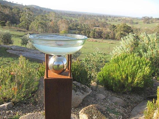 """Mica Grange Garden: """"Birdbath and Ball""""by Manning Sculptures Protea Garden overlooking the  Sutton Grange Valley"""