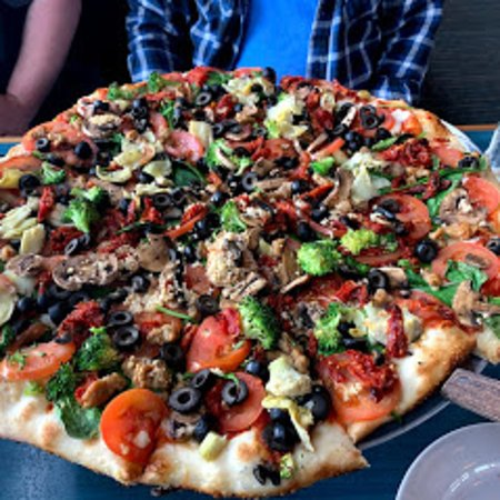 Sammamish, WA: Kitchen Sink Pizza.  Pepperoni, Canadian Bacon, Italian Sausage, Chicken, Bacon, Mushroom, Black Olive, Green Pepper, Tomato, Fresh Garlic.