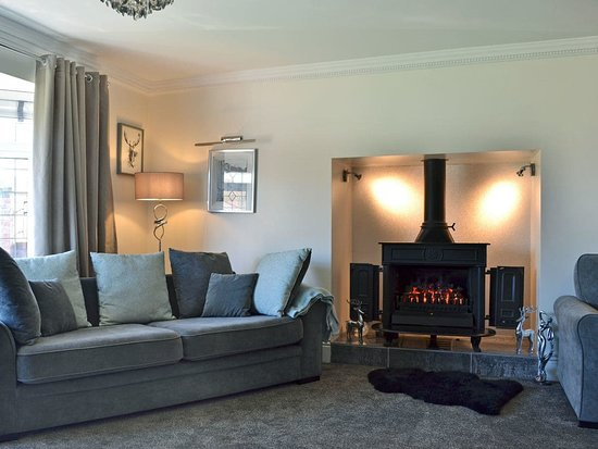 "New Ellerby, UK: The main living room has a 70"" Sky TV and deep, comfortable sofas making it the ideal spot to relax and unwind whilst watching your favourite film after a long day of exploring."