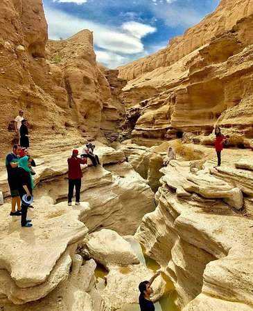 South Khorasan Province, Iran: #Kal_e_Jenni is a beautiful valley, 35 kilometers far from #Tabas city in Sout #Khorasan Province. By entering this area, the desert landscapes completely fade. #Kal means #valley which is formed by seasonal floods.  #Jenn means #jinn ; So the meaning of Kal-e Jenni is the #valley_of_jinn . The appellation of the valley must be related to the strange rocks and tall stone walls. Natural erosion process had a significant role to form this valley. Most of the landforms are the results of a thousand