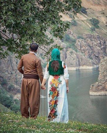 Kordestan Province, Iran: Amazing Kurdistan🌱🍃  Kurdish couple in traditional attire and magical view over beautiful landscape of Hawraman, Kurdistan.❤️