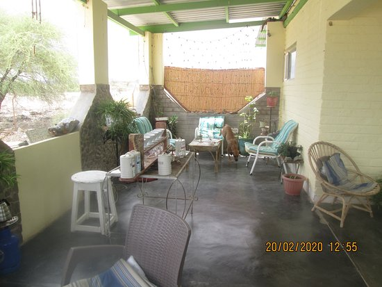 Rehoboth, Namibia: Patio area at cafe, look carefully & you can see this exquisite coffee-making equipment.  His dog decided to mosey off as he not into coffee!