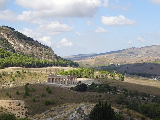 The Archaeological Park of Segesta, located 40 km from Trapani,  is an authentic open-air museum that preserves one of the most famous Doric temples in the world by state of conservation. The ancient Segesta rises in a splendid position, among rocky rolling hills covered in the typical Mediterranean vegetation.  Here is our suggested itinerary to visit Western Sicily in 2 weeks:  https://travelaroundtheclock.blogspot.com/2019/12/15-days-itinerary-in-western-sicily.html