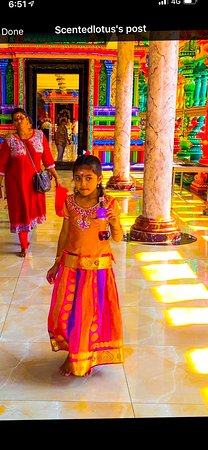 Malaysia: Mother and daughter in the temple at the foot of Batu Caves holy shrines