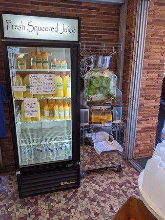 Floral City, FL: Making their own orange juice.