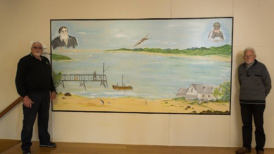 Port Sorell history painting at the Memorial Hall. With Cartaker Mr R Donaghue and artist Frank Stolp