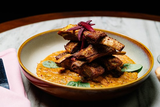 Daal Gosht - Five mouth watering lamb ribs, served on a bed of yellow daal. Crowd favorite (and pleaser) !