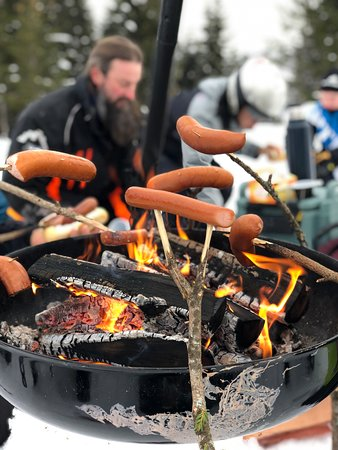 Roasting hotdogs in the snow after a morning of snow fun