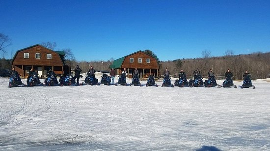 Bingham, ME: lined up in front of the cabin after our ride
