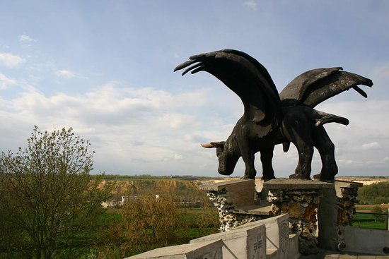 """Eben-Emael, Бельгия: The Bull looking towards the Nort-East, the land of the """"Gueux""""..... One of the four winged creatures that Robert Garcet build on top of his tower."""