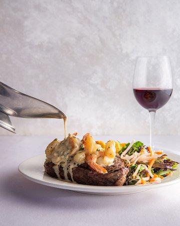 Porter House Steak Topped With Garlic Prawns