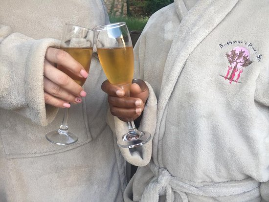 Ladies in Spa gowns enjoying a glass of sparkling wine at Bushman's rock spa in Waverley Pretoria