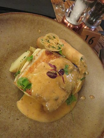 Kilve, UK: From the specials board - Pan roasted fillet of halibut with Devon crab spring roll and creamy shellfish sauce