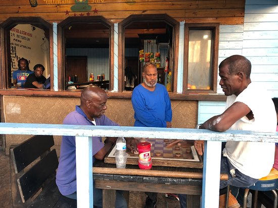 Potters Cay Fish Shacks: Locals having a drink at Potters Cay