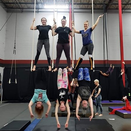 hanging around on the triple trapeze in Trapeze 1 class.
